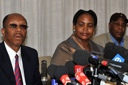 South Africa said it could not hold Aristide, left, hostage if he wanted to go home [AFP]